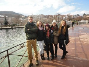 Aida Marcantonio and friends standing beside a river in Annecy, France