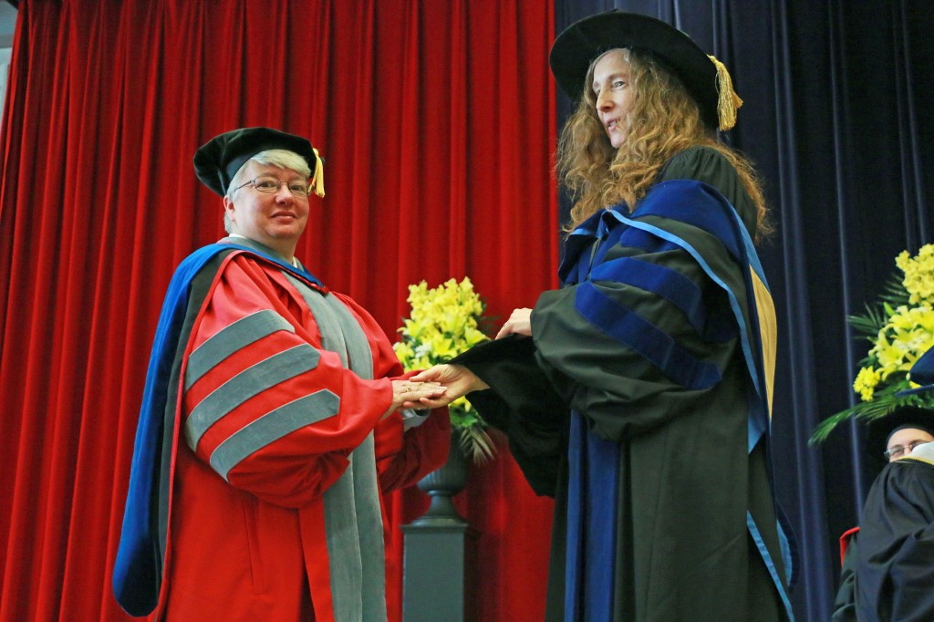 Carol Merriam, Dean of the Faculty of Humanities, awards Professor Allison Glazebrook with the Faculty Award for Excellence in Teaching at the Friday, June 8 Spring Convocation ceremony.
