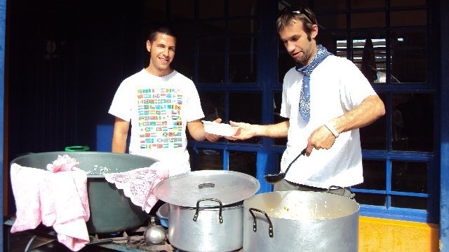 Patric Poulin, left, and Andrew Barclay serve food at the Moses Garob Youth Centre.