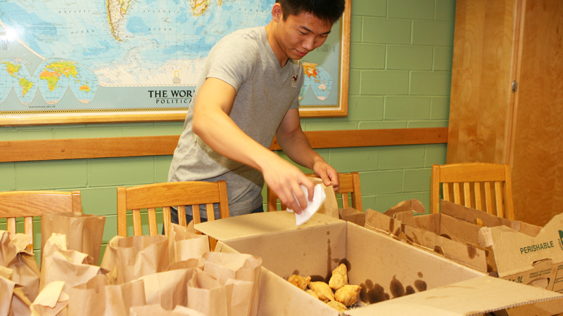 Tony Wu packs samosas