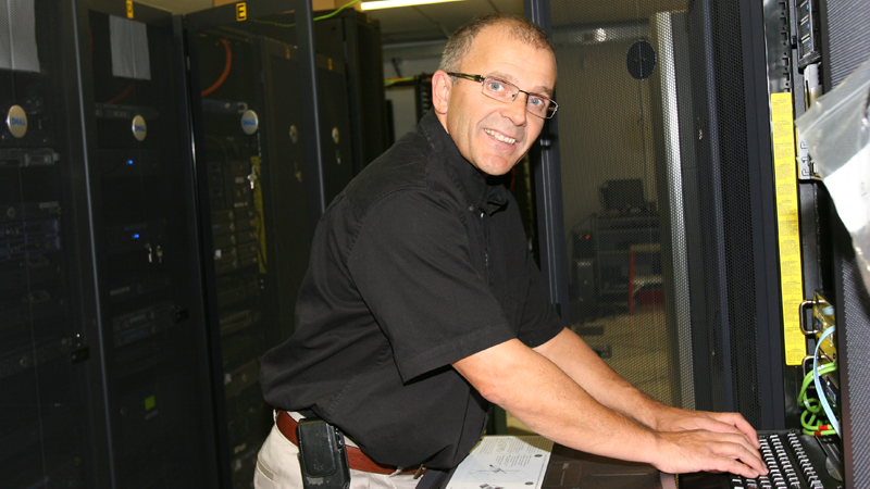 Andy Morgan stands in the server room, a climate-controlled space holds dozens of servers that hold brocku.ca websites, email messages and other data.