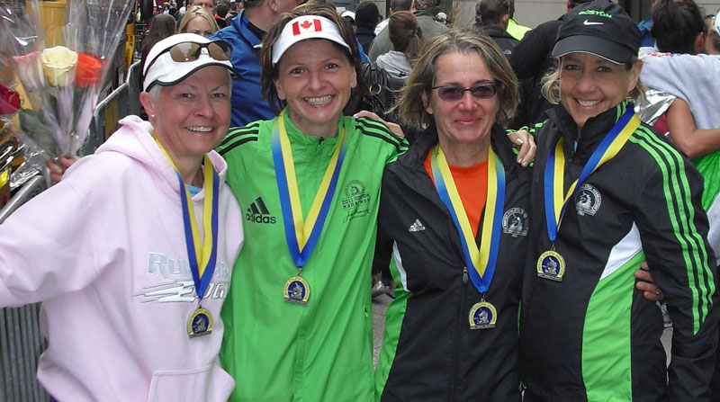 Barb Davis poses with her co-runners after the Boston Marathon. From left: Cathy Hopkins, Cathy Belice, Klari Kalkman and Davis