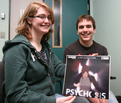 Jessica Trunk and Andrew Greenizan display a promotional poster for Psychosis.