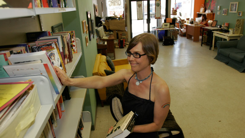 Lisa Kretz shelves books at OPIRG Brock's downtown Infoshop.