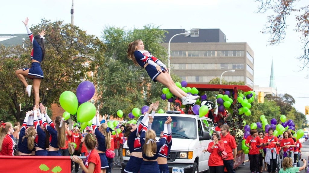 Brock University cheerleaders pump up the crowd at the Niagara Wine Festival's Grande Parade in this file photo.