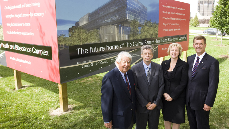 Roy Cairns poses with son John, daughter-in-law Kitty and son Jeff Cairns at the naming of the Cairns Family Health and Bioscience Research Complex.