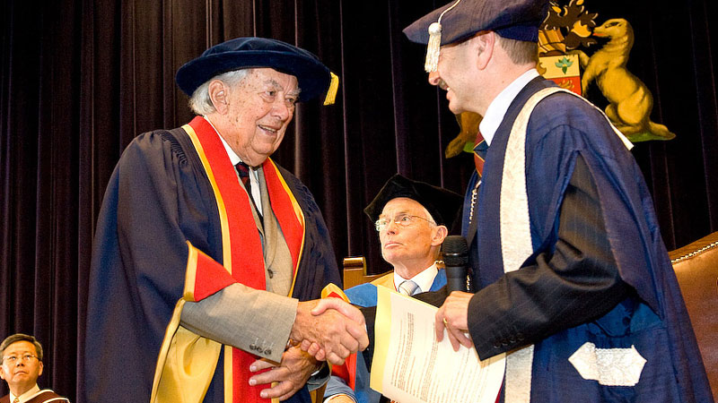 Roy Cairns receives an honorary degree from President Jack Lightstone, right, during Spring Convocation in 2009.