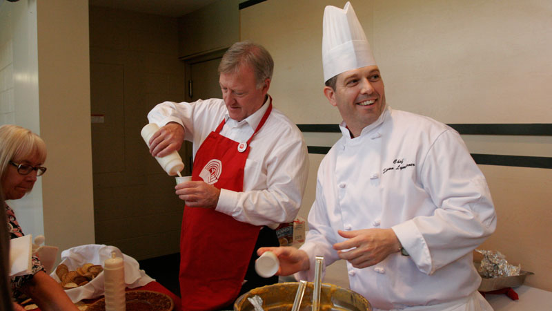 Neil McCartney, left, and Shawn Lymburner serve up soup.
