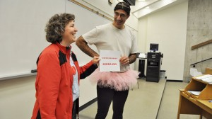 David Gabriel, right, presents a cheque to Lucie Thibault, faculty co-chair of Brock's United Way campaign.