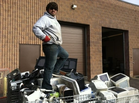 Ryan Dear (BBA '11), owner of Niagara E-Waste, posed with recycled electronics after a successful event