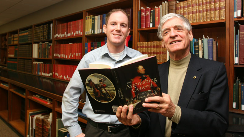 David Sharron, left, and Wesley Turner check out Astonishing General, Turner's new book about Sir Isaac Brock.
