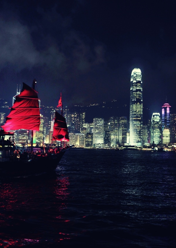"""I took a trip to Hong Kong in the summer and find that night scene attracts me the most,"" writes Wen. ""When I enjoy the view in the Victoria Harbour, a ship with red sail came into my sight. With brilliantly illuminated building across the harbor, I took this picture."""