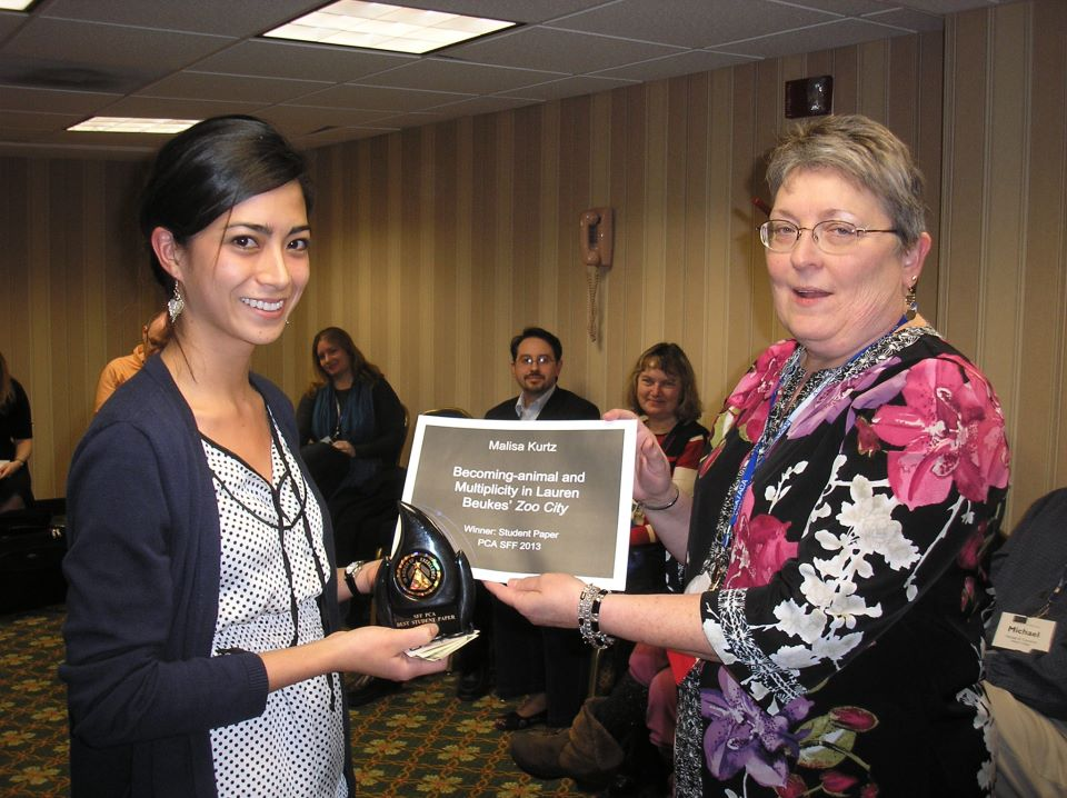Malisa Kurtz receives her Graduate Student Scholar Award at a recent conference in Washington, D.C.