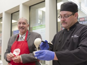 Graduate Studies Dean Mike Plyley and Dining Services Chef Jim Harper serve up Dutch potato soup at the Souper Star Lunch in this file photo.