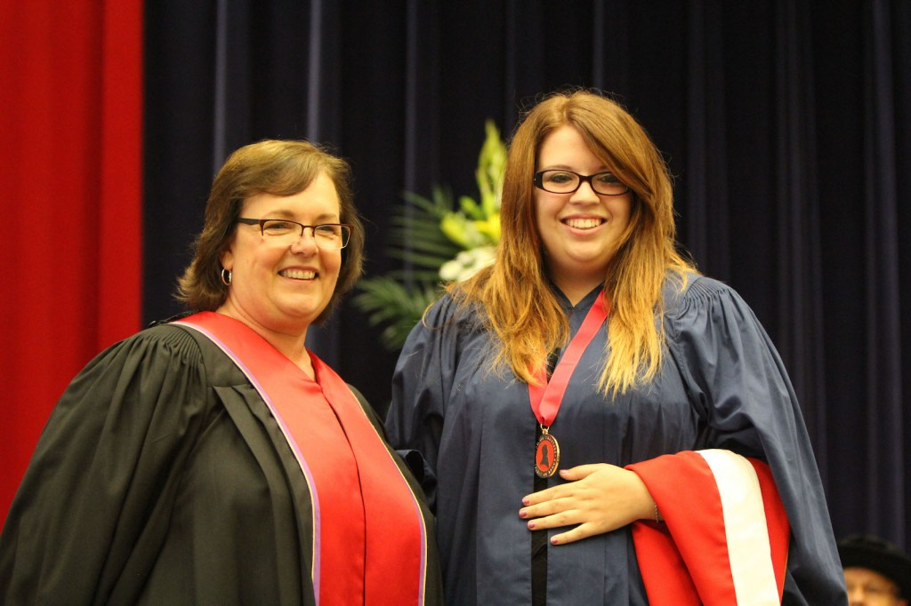 Kaitlin McKay (right) was presented the Spirit of Brock medal Tuesday by Kristine Freudenthaler of Brock's Board of Trustees.
