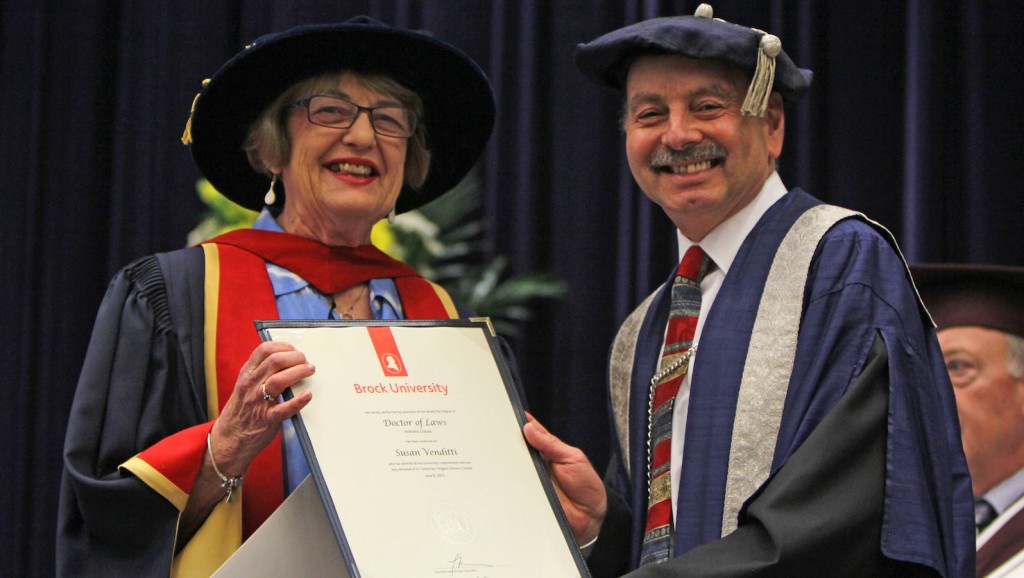 Susan Venditti, executive director of Start Me Up Niagara, receives an honorary degree from Brock President Jack Lightstone at Tuesday's Social Sciences convocation ceremony.