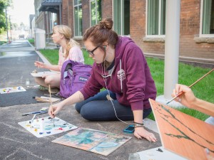 Students plein-air paint outside the MIWSFPA.