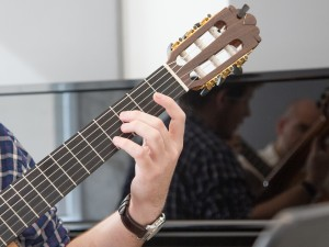A guitarist works with an instructor in one of the music studios in the MIWSFPA.