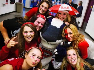 Brock University students pose with Boomer the Badger before a hockey game during the 2014 Steel Blade Tournament.