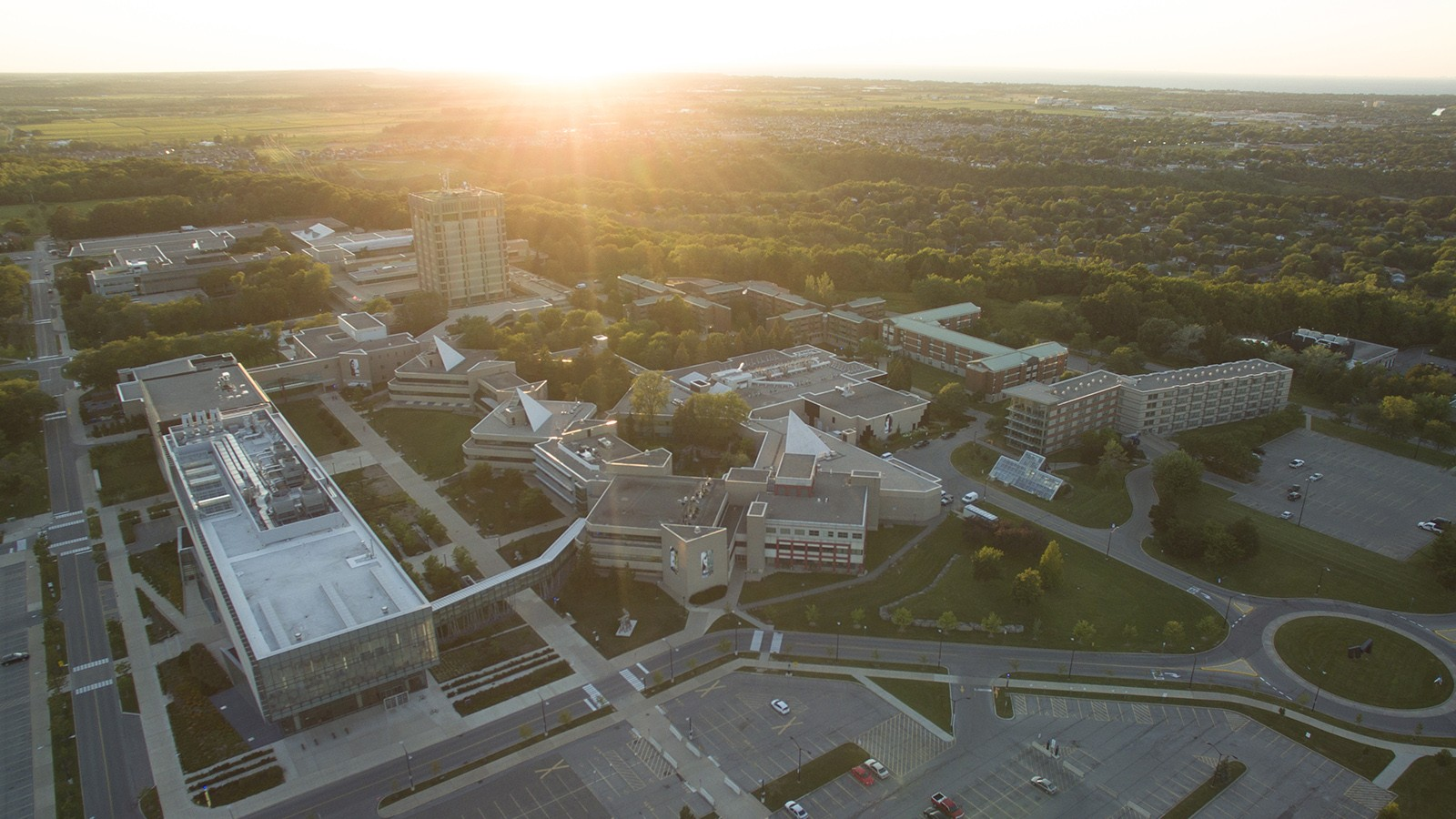An aerial view of the Brock University campus at sunset.