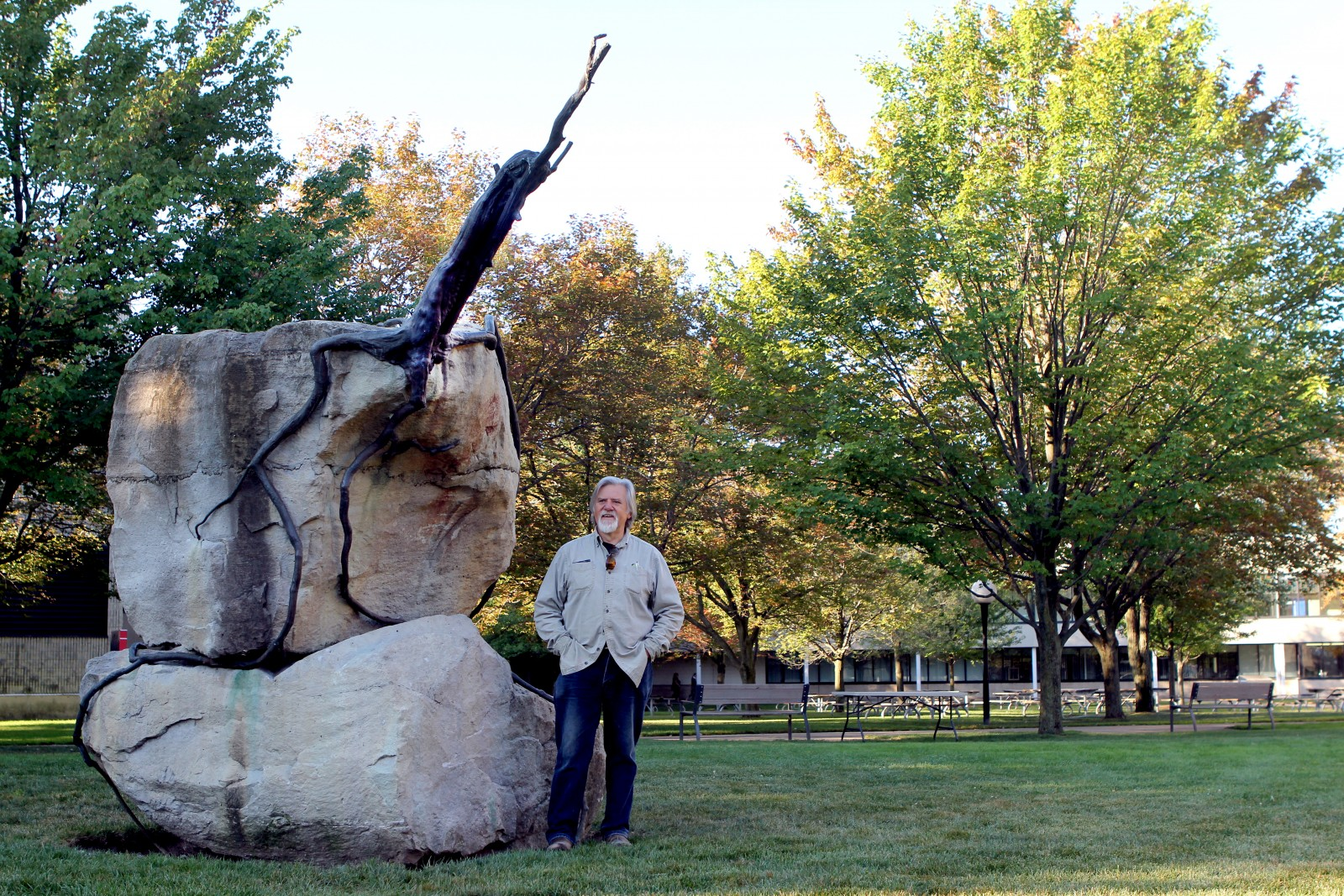 Canadian artist Reinhard Reitzenstein stands beside his sculpture 2000 years on the Edge, which is moving from Jubilee Court where it's pictured, to a spot between the Plaza Building and Cairns Complex.