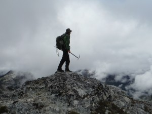 Man standing on a mountain with clouds
