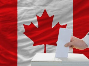 Man puts ballot in voting box in front of Canadian flag in this graphic.