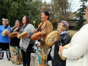 Women perform the Strong Women's Song Friday in front of the Brock statue during the Sisters in Spirit Vigil for Missing and Murdered Aboriginal Women and Girls.
