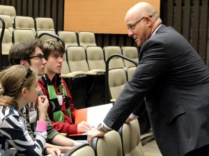 Brock University Vice-President of Finance and Administration Brian Hutchings talks to Grade 12 Eastdale Secondary School students Jenny Schaefer, Malcolm Allcorn and Luc Grenier, Oct. 14 during the Niagara Student Summit.