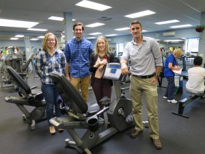 Students in front of an exercise machine
