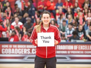 An athlete holding a thank you sign