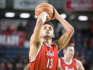 Dani Elgadi takes a shot at a basket.
