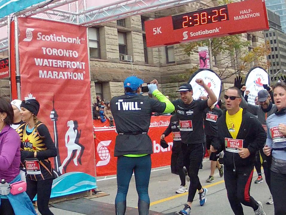 Robert MacDonald crosses the finish line in the Scotiabank half-marathon in Toronto.