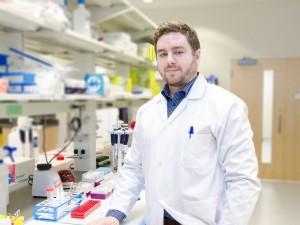 Adam MacNeil pictured in a lab.