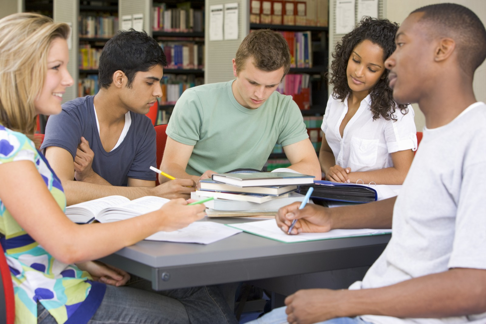 Students study together in a library.