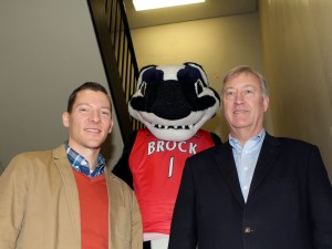 Brock University Provost and Vice-President, Academic, Neil McCartney, right, Boomer the Badger and Interim University Librarian Jonathan Younker in the library stairs to promote the #LibraryStairsChallenge.