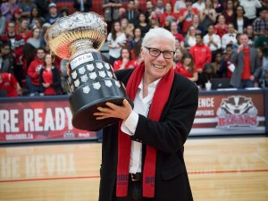 Brock University's Assistant Athletic Director Chris Critelli holds up the OUA trophy that's been renamed the Critelli Cup in her honour.