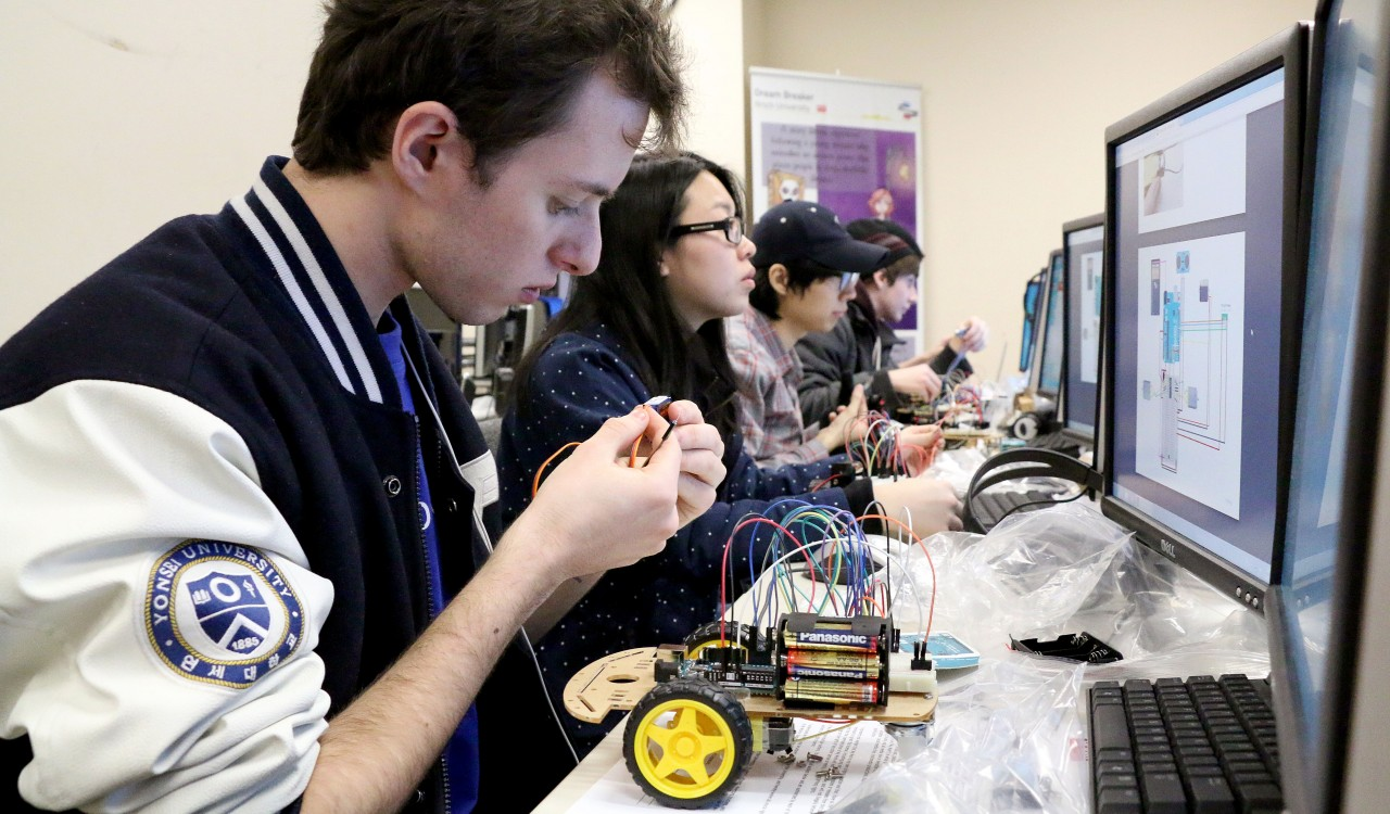 Adam Balint, a fourth-year computer science student taking part in the Brock University Design Studio (BUDS) program, works on the Brock/IBM Arduino Project, which will see IBM distribute an autonomous rover to Grade 8 students.
