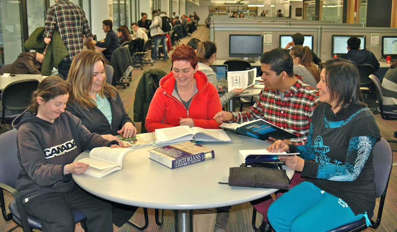 Hitting the books in Brock's Matheson Learning Commons: From left, Jennifer Nixon, Toronto (Mohawk nation) who is studying Film Studies; Jody General, Ohsweken (Mohawk), in Business Administration; Terra Wott, St Catharines (Mi'kmaq), double major honours Psychology and Women's and Gender Studies; Ryan H. Wijesirigunawardenae, Niagara (Dene), Medical Sciences with minors in Labour Studies, Biology, Physics; and Beverly Bannon, Anemki-wajiw (Thunder Mountain) (Ojibway), Master's in Education Curriculum Development with minor in Aboriginal Studies.