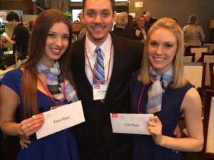 Winners of the 2015 Grant Dobson Case Competition, Shannon O'Rourke, left, Michael Sibbins, and Tina Vanderlinden.