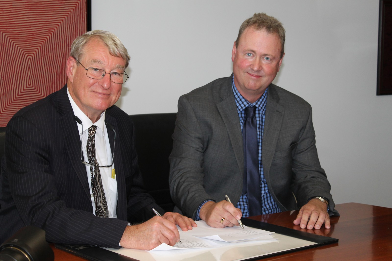 University of the Sunshine Coast's Vice-Chancellor and President Professor Greg Hill with Brock Professor Gary Pickering at the MOU signing. Photo by Terry Walsh.