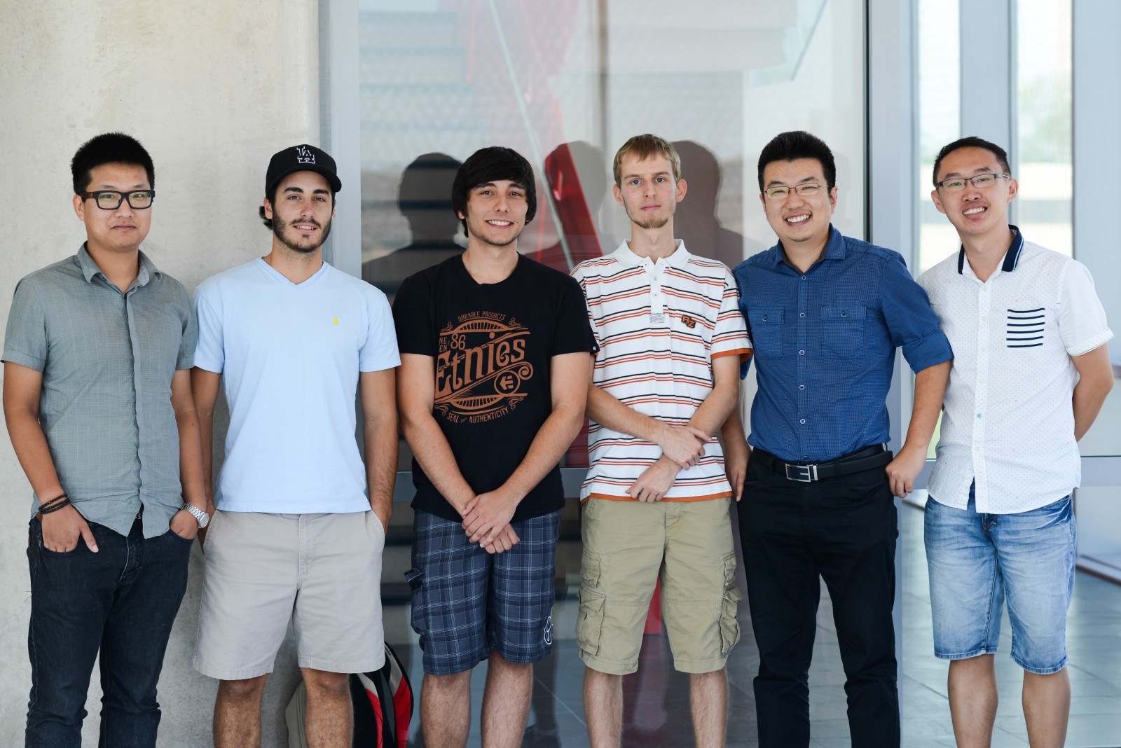 The Brock University research team exploring the use of nanobots to fight disease includes: Xiaolong Yang, left, Sean Mason, Trevor Ealaschuk, Ryan Alt, Feng Li, and Zechen Yu.