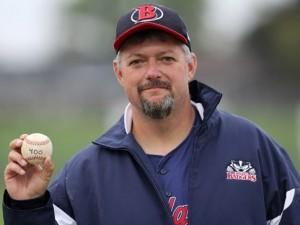 Jeff Lounsbury with a baseball