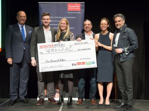 Madi Fuller and Harrison Olajos accept their winning investment from Monster Pitch judges Jim Treliving, left, Deborah Rosati, Jason Sparaga and Bruce Croxon.