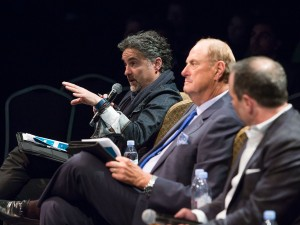 Monster Pitch judge Bruce Croxon gives feedback to competitors while Jim Treliving and Jason Sparaga look on.