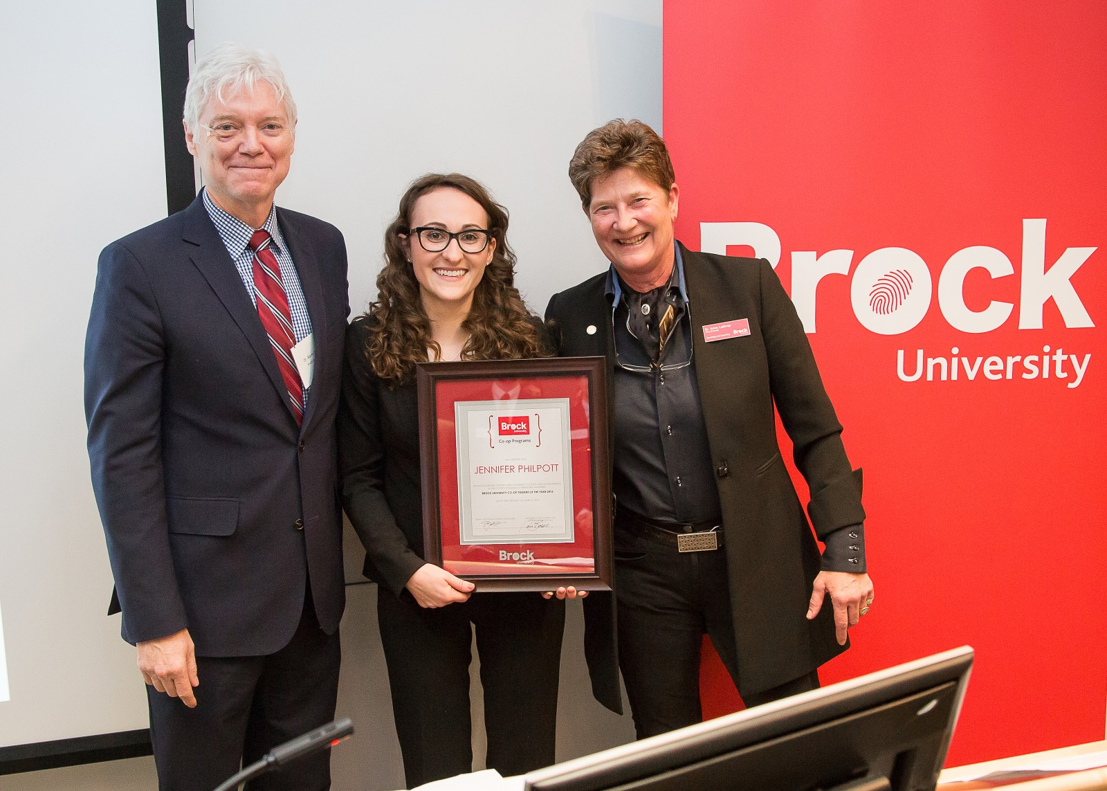 Jennifer Philpott, middle, received the Co-op Student of the Year Award for 2015 from Interim Dean of the Goodman School of Business Barry Wright and Vice-Provost of Teaching and Learning Anna Lathrop.