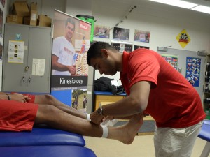 Brock Kinesiology student Omer Suhrawardy is shown in the training room at Brock University.