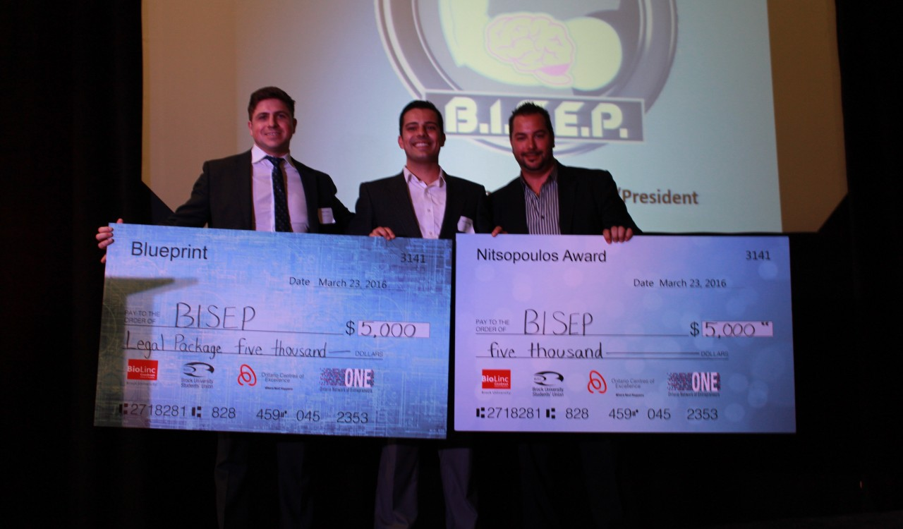 Blueprint winner Daniel Bordenave, middle, accepts cheques from Ryan Hayes of Fogler Rubinoff, LLP, left, and Tom Nitsopoulos of Heart of Niagara Hotels.