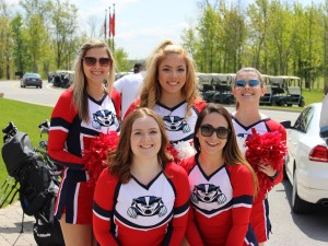 Cheerleaders pose for a photo.