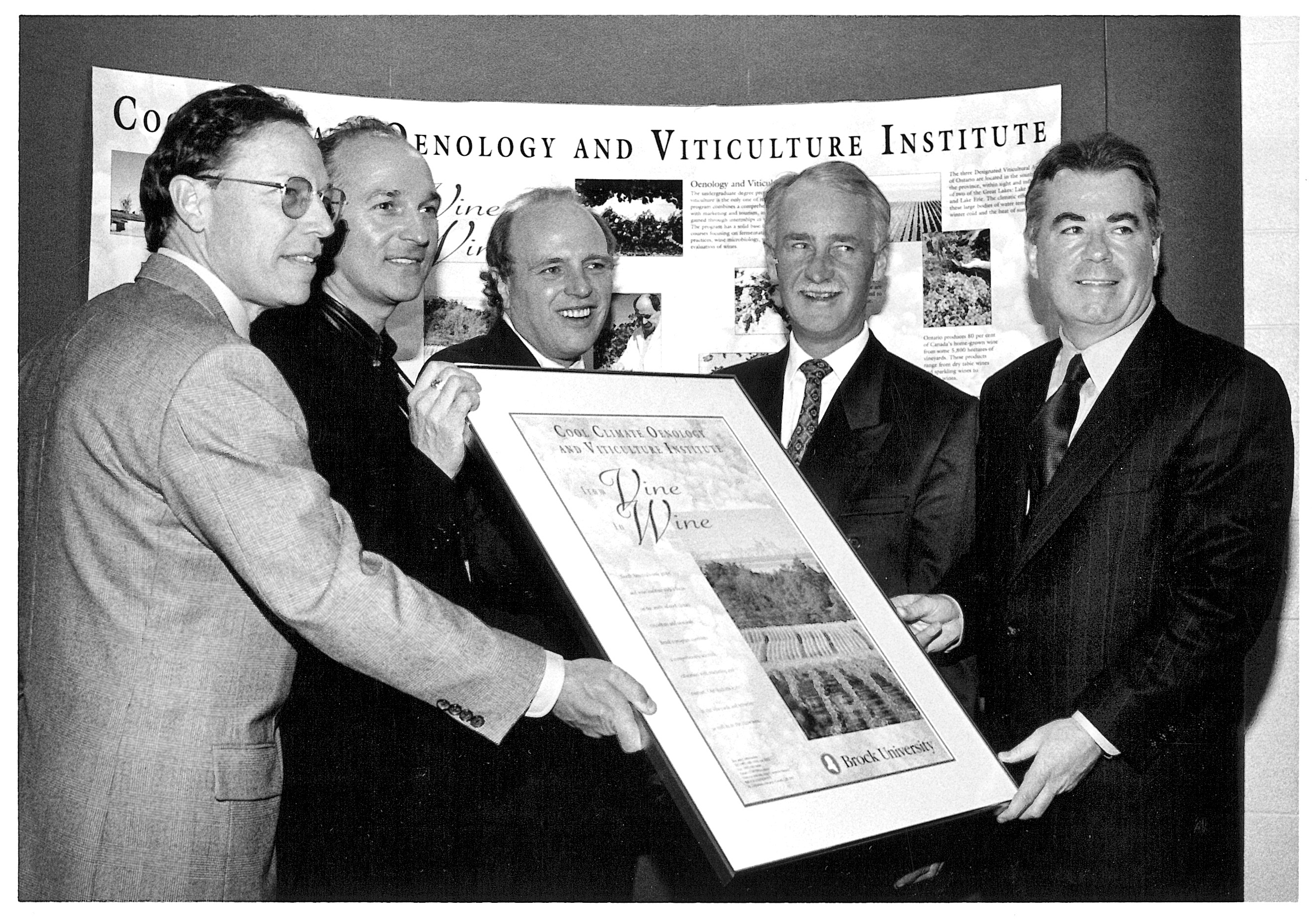Dec. 11, 1996 — Brock establishes the Cool Climate Oenology and Viticulture Institute. Bill Cade (centre), Dean of Mathematics and Science, is flanked by (from left) grape and wine industry officials Bruce Walker, Donald Ziraldo, John Neufeld and John Howard.